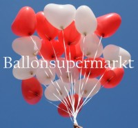 Doch so schön, wie diese Herzluftballons jetzt im Glanz der Hochzeitsfeier an den Bändern baumeln, hat man es sich nicht vorstellen können