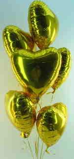 Herzballons in goldenen Farben